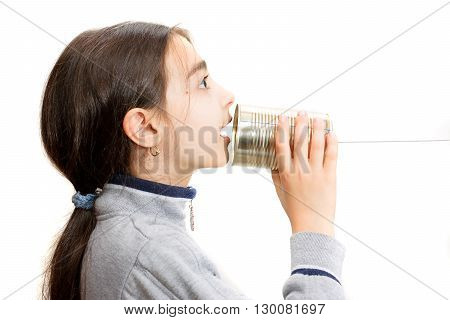 little girl speaking in the phone built with the jar
