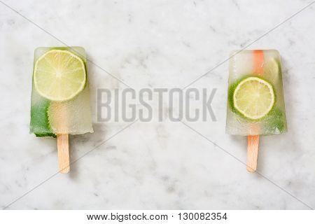 Fresh summer lime popsicle on white marble