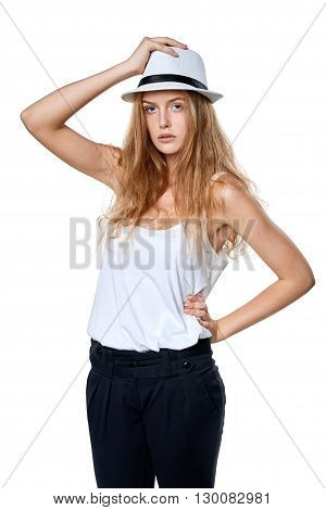 Beautiful woman in straw hat posing over white background