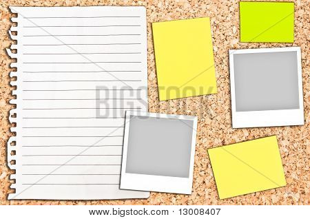 Cork Board With Empty White Page And Notes