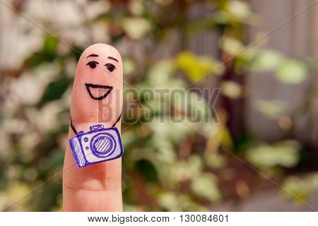 finger painting. Positive Photographer with camera outdoor