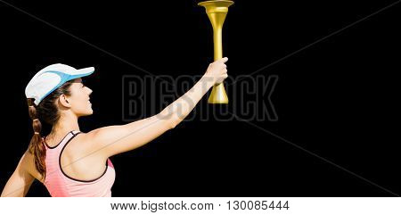 Rear view of happy sportswoman holding a cup