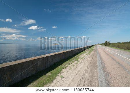 Empty asphalt road built along the seaside.