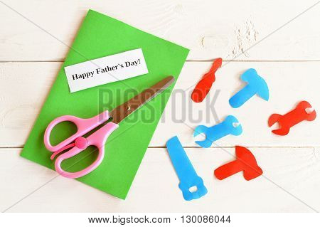 Paper tools, scissors, set for greeting card father's day. Happy father's day. How to make a greeting card. Kids crafts idea. Craft concept