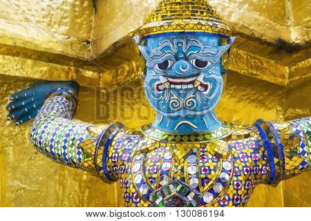 Guardian demon at Wat Phra Kaew temple, Grand Palace in Bangkok, Thailand.
