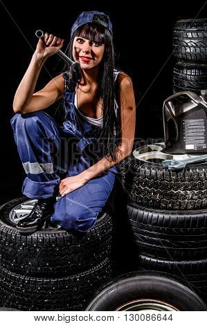 Sexy Young Woman Sitting On A Tires
