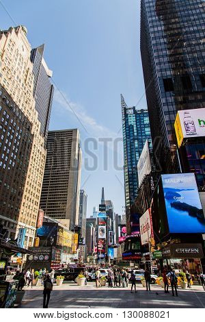 NEW YORK, USA - APRIL 21, 2016: Unidentified people on the Times Square New York. Times Square is the most popular tourist location in New York City.