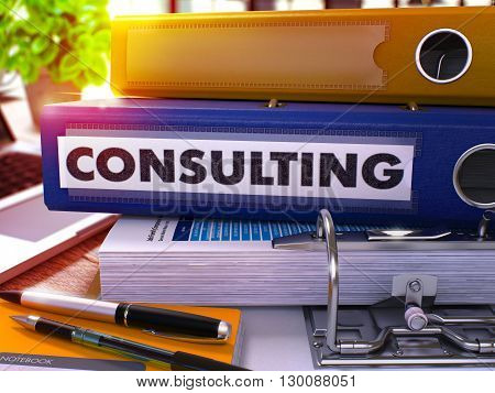 Consulting - Blue Ring Binder on Office Desktop with Office Supplies and Modern Laptop. Consulting Business Concept on Blurred Background. Consulting - Toned Illustration. 3D Render.