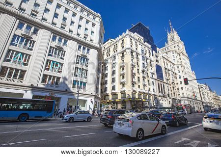 MADRID, SPAIN - MARCH 16, 2016: Unidentified people at Gran Via in Madrid. It's the oldest and main shopping street in Madrid.