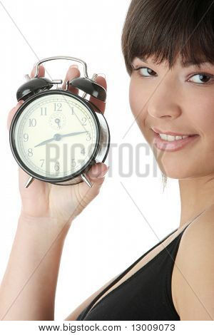 A young woman with alarm clock isolated