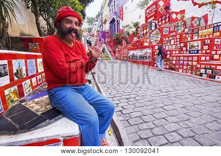 Rio de Janeiro, Brazil - October 2, 2012: The late Chilean-born artist Jorge Selaron at his most famous creation Escadaria Selaron, or Lapa Steps, in Rio de Janeiro, Brazil.
