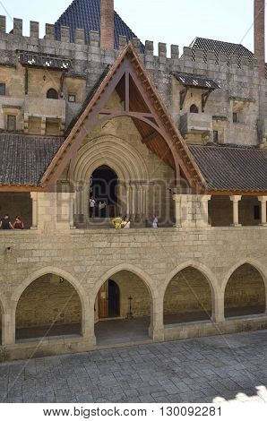 GUIMARAES, PORTUGAL - AUGUST 9, 2016: People at the entrace of the chapel of the Palace of the Dukes of Braganza of Guimaraes in the northern region of Portugal.