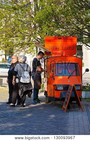 BRATISLAVA, SLOVAKIA - MAY 16, 2016: Customers waiting for their coffee at a mobile coffee shop in Bratislava on May 16, 2016.