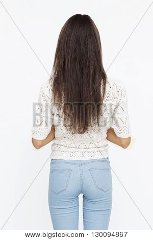Happy Young Woman turned back Isolated On White Background