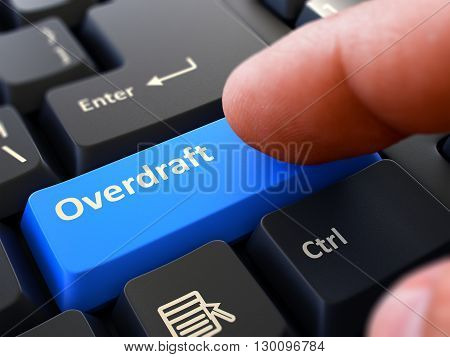 Computer User Presses Blue Button Overdraft on Black Keyboard. Closeup View. Blurred Background. 3D Render.