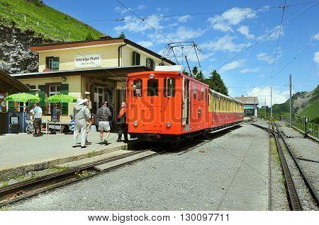Schynige Platte Switzerland - July 08 2012: Retro passenger train is ready to depart to Interlaken.