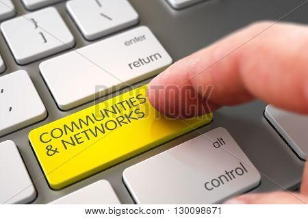 Hand Touching Communities and Networks Button. Hand Pushing Communities and Networks Yellow White Keyboard Key. Communities and Networks Concept - White Keyboard with Button. 3D Render.