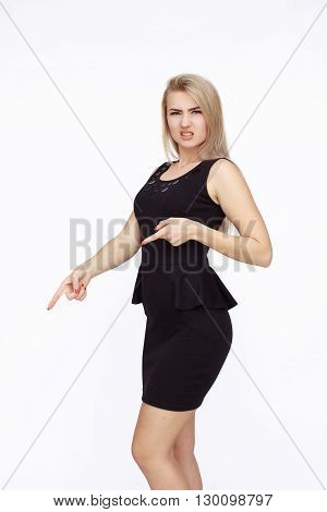 Young angry woman showing something disgusting on white background.