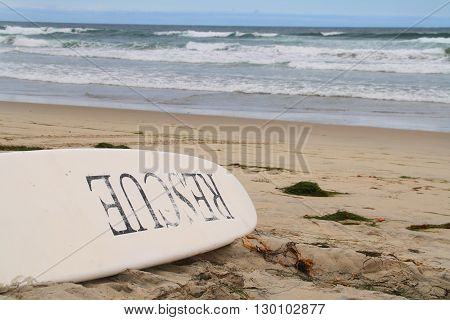 Rescue Board On The Beach (lifeguard surfboard on the beach)