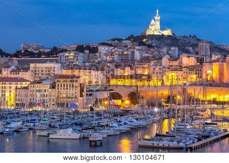 Marseille, France at night. The famous european harbour view on the Notre Dame de la Garde