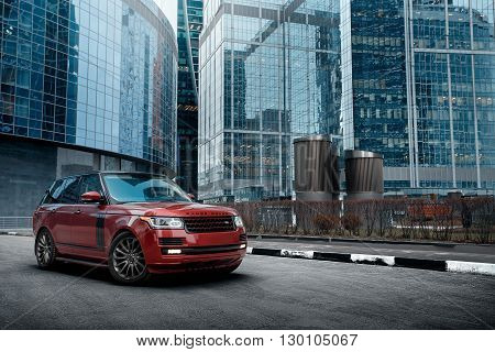 Moscow, Russia - November 22, 2015: Premium car Land Rover Range Rover stay near modern building in the city at daytime
