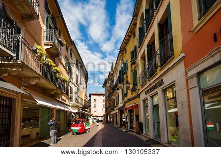 Peschiera del Garda Italy - May 03 2016: View of the Dante street in the pedestrian area of the old town