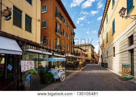 Peschiera del Garda Italy - May 03 2016: Cyclist rides along the pedestrian area of the old town