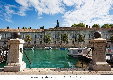Peschiera del Garda Italy - May 03 2016: Old gate to the marina in canal of old town