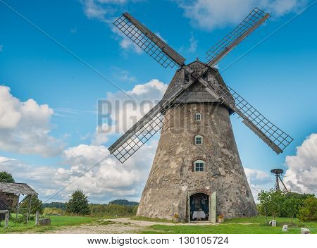Old windmill in Vidzeme region of Latvia - one of the ecologically cleanest nature territories in Europe where medieval history meets with marvelous scenic landscapes