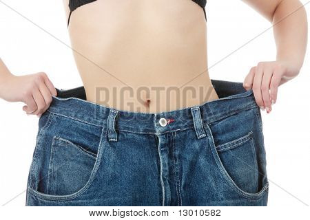 Teen woman showing how much weight she lost. Isolated on white