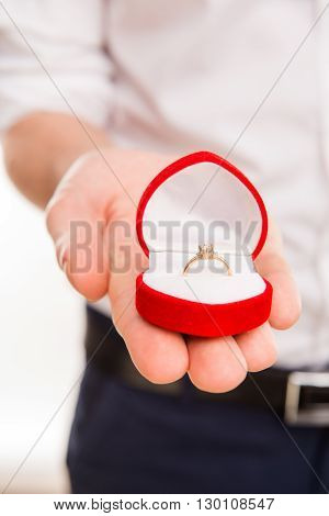 Close Up Photo Of Man's Hand Holding Box With Wedding Ring