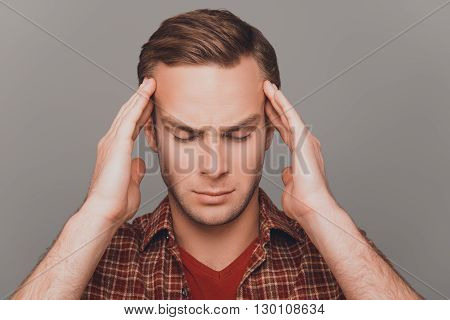 Handsome Man Touching His Head Suffering From Headache