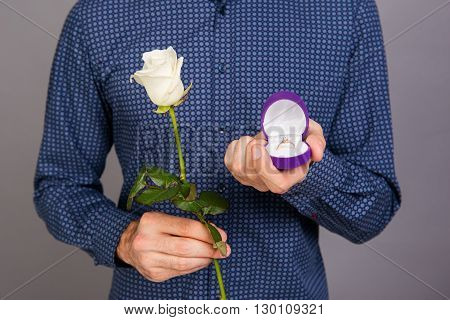 Close Up Photo Of Man With White Rose Going To Make Marriage Proposal