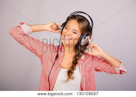 Positive Smiling Music Lover Listening Music In Headphones