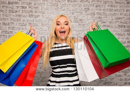 Happy Cheerful Girl Holding Pacs With New Clothes