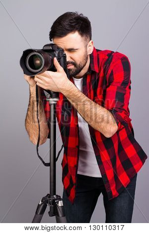 Portrait Of Young Successful Photographer Taking Photos In Studio