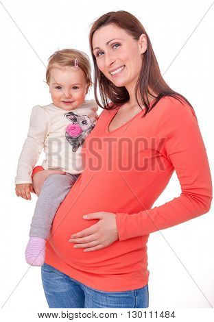 mother holding tummy with new sister