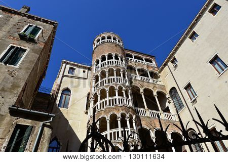 VENICE, ITALY - JULY 31: Beautiful renaissance spiral staircase in the center of Venice, one of the most famous tourist attraction in the city, seen from below JULY 31, 2015 in Venice, Italy
