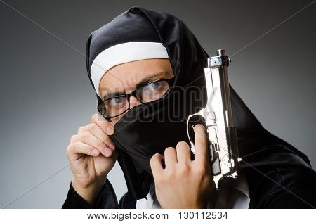 Man dressed as nun with handgun