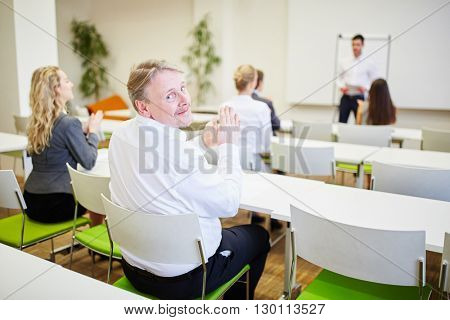 Audience applauds in a business seminar after a presentation