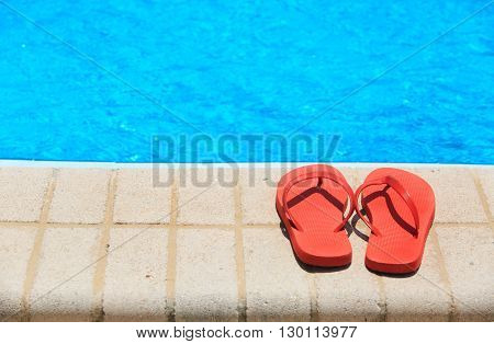 sandals by the pool, vacation relax concept