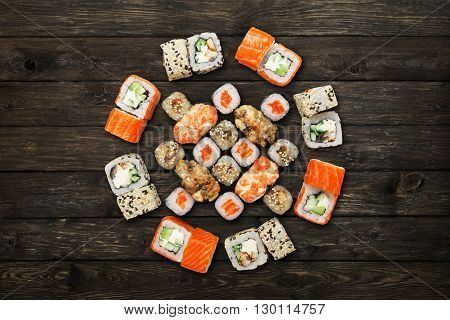 Japanese food restaurant, sushi maki gunkan roll plate or platter set. Sushi at rustic wood background. Top view, flat lay. Big party sushi set.