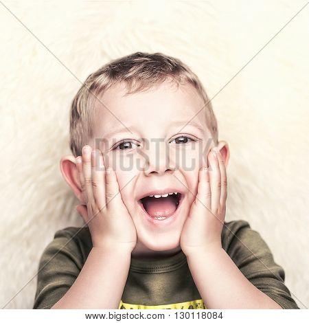 happy child portrait and fur background