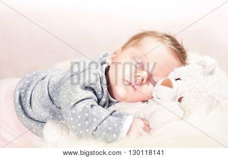 sleeping femal baby on classic white fur