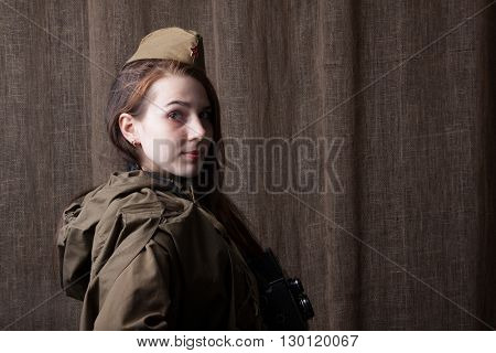Woman in Russian military uniform. Female soldier during the second world war.