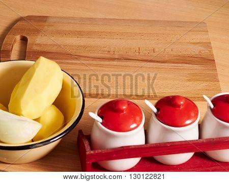 Onion And Potato In Plate On Table.