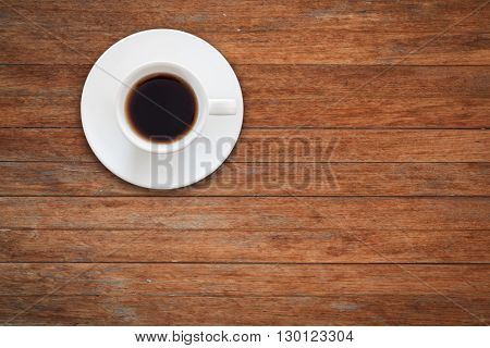 Close up white coffee cup on wooden table, stock photo