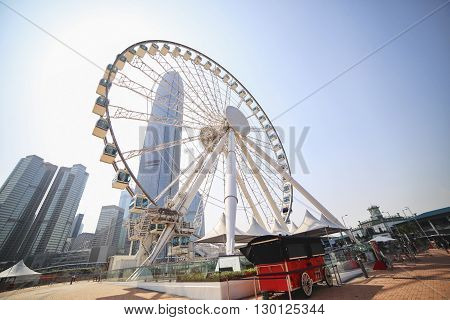Ferris wheel on a background of blue sky and skyscrapers. Skyline.
