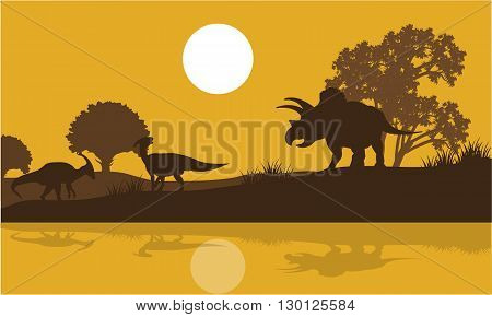 Silhouette of triceratops and parasaurolophus in river at the morning