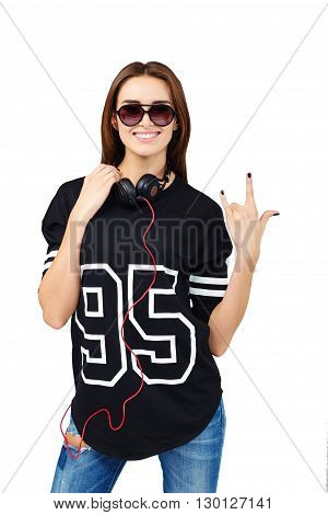 DJ with earphones in jeans and black shirt
